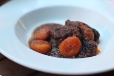 Stewed pork cheeks with dried apricots and red wine
